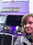 The author of the blog stands infront of the purple Knight Bus from Harry Potter and the Prisoner of Azkaban